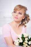 Beautiful blonde woman with a bouquet of tulips Stock Photography