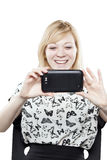 Beautiful blonde woman in business attire holding mobile phone Royalty Free Stock Photos