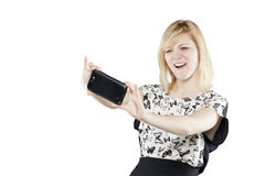 Beautiful blonde woman in business attire holding mobile phone Royalty Free Stock Photography
