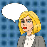 Beautiful blonde woman in business smart suit with speech balloon Stock Photography