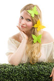 Beautiful blonde woman with butterfly decoration. Royalty Free Stock Photography