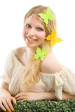 Beautiful blonde woman with butterfly decoration. Stock Photo