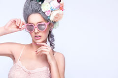Beautiful blonde woman with a cake. Sweet sexy lady with heart glasses. Vintage style. Fashion photo Royalty Free Stock Image