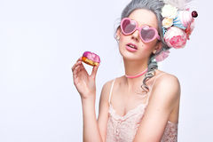 Beautiful blonde woman with a cake. Sweet sexy lady with heart glasses. Vintage style. Fashion photo Royalty Free Stock Photos