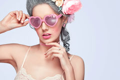 Beautiful blonde woman with a cake. Sweet sexy lady with heart glasses. Vintage style. Fashion photo with copy space Royalty Free Stock Photography