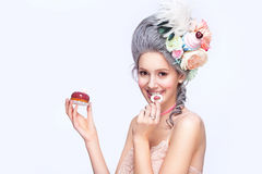 Beautiful blonde woman with a cake. Sweet sexy lady. Vintage style. Fashion photo Stock Photos