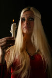 Beautiful blonde woman with candle in hand Royalty Free Stock Photos