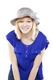 Beautiful blonde woman in casual attire with hat. Against white background Stock Photos