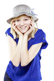 Beautiful blonde woman in casual attire with hat. Against white background Royalty Free Stock Image