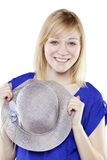 Beautiful blonde woman in casual attire with hat Stock Images