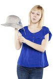 Beautiful blonde woman in casual attire with hat. Making a funny face Stock Image