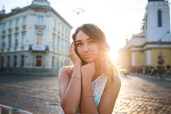 Beautiful blonde woman with charming smile posing at the sunrise. Beautiful young  blonde woman with charming smile posing at the sunrise and sun glare Stock Photos