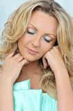 Beautiful blonde woman with closed eyes. Stock Images