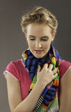 Beautiful blonde woman with colorful clothing Stock Photography