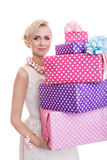 Beautiful blonde woman with a colorful gift boxes Royalty Free Stock Photography