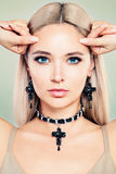Beautiful Blonde Woman with Coloring Hair and Jewelry Earrings. And Necklaces royalty free stock photography