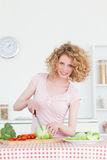 Beautiful blonde woman cooking Royalty Free Stock Photography