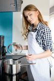 Beautiful blonde woman cooking Royalty Free Stock Photo