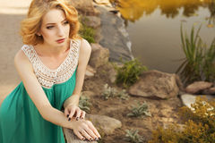 Beautiful blonde woman with curly short bob hairstyle, delicate Stock Photos