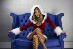 Cute santa woman. Beautiful blonde woman dances in cute santa claus costume for christmas time disco shoot Royalty Free Stock Photography