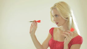 Beautiful blonde woman with darts stock footage