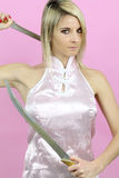 Beautiful blonde woman dressed in ninja Stock Photo