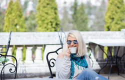 Beautiful blonde woman drinking coffee happy Royalty Free Stock Photo