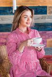 Beautiful blonde woman drinking coffee or tea in the morning and smiling. Lifestyle, happiness. Life concept Stock Photo