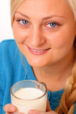 Beautiful blonde woman drinking milk Stock Photos