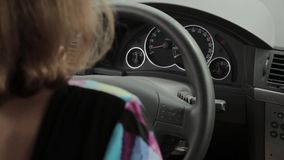 Beautiful blonde woman is driving and calling by phone stock video footage