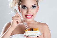 Beautiful blonde woman eating Royalty Free Stock Photos