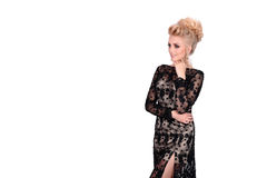Beautiful blonde woman in elegant black evening dress with updo hairstyle. Lady looking over her shoulder on white Royalty Free Stock Photo