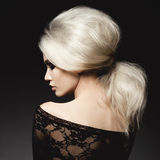 Beautiful blonde woman with elegant hairstyle Stock Photos