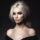 Beautiful blonde woman with elegant hairstyle Stock Image