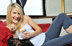 Beautiful blonde woman enjoying ice cream Royalty Free Stock Photos
