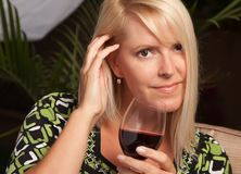 Beautiful Blonde Woman Enjoying Wine Royalty Free Stock Photos