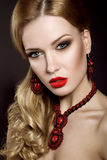 Beautiful blonde woman with evening make-up and red lips Stock Photos