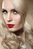 Beautiful blonde woman with evening make-up and red lips Royalty Free Stock Image