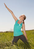 Beautiful blonde woman exercising in the outdoors yoga photo Stock Image
