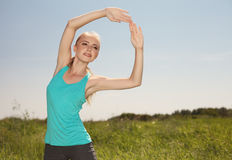 Beautiful  blonde woman exercising in the outdoors yoga photo on Stock Photo
