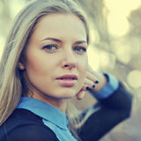 Beautiful blonde woman face. Close up portrait of a fashion female model stock photos