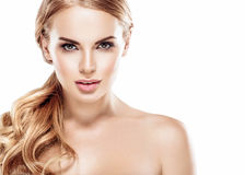 Beautiful blonde woman face close up portrait studio on white Stock Image