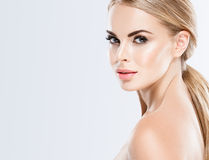 Beautiful blonde woman face close up portrait studio on white Stock Photo