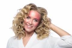Beautiful blonde woman face with pink makeup Stock Photos