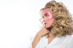 Beautiful blonde woman face with pink makeup. Royalty Free Stock Photos