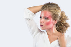 Beautiful blonde woman face with pink makeup. Royalty Free Stock Photography
