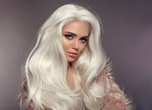 Beautiful Blonde Woman In Faux Fur Coat. Portrait Of Young Royalty Free Stock Images