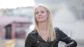 Beautiful blonde woman flirting with someone. Attractive girl looks aside, gives an air-kiss and smile. stock footage