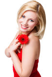 Beautiful blonde woman with a flower royalty free stock photography