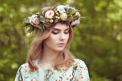 Beautiful blonde woman with flower wreath on her head Royalty Free Stock Images